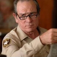 Tommy Lee Jones With A Newspaper