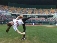 A Rhythmic Gymnast's First Pitch