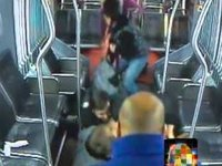 Bus Passengers Take Down Robber