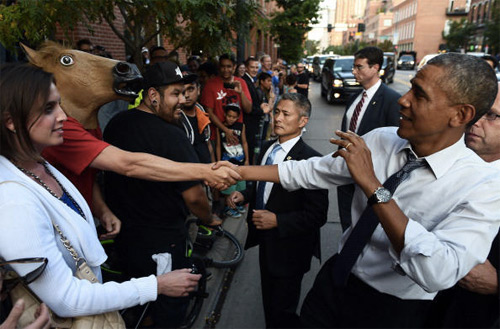 Obama Shakes Hands with a Horse Head Guy