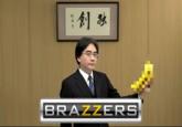Satoru Iwata Holding Bananas