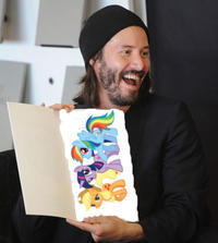 keanu-reeves-book-signing-06192011-lead-ponies.jpg