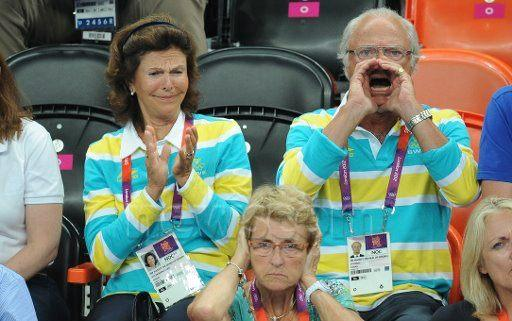 The Queen and King of Sweden watching soccer