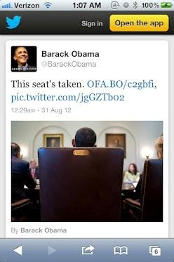 Obama sitting in a chair
