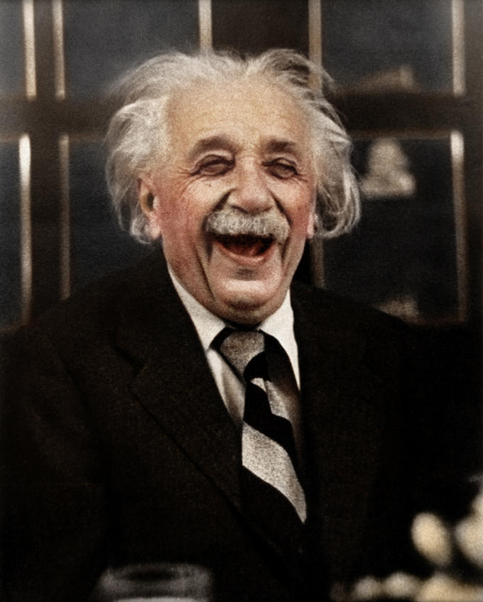 Albert Einstein Laughing During a Dinner