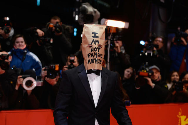Actor Shows Up at Press Conference with a Brown Bag Over His Head