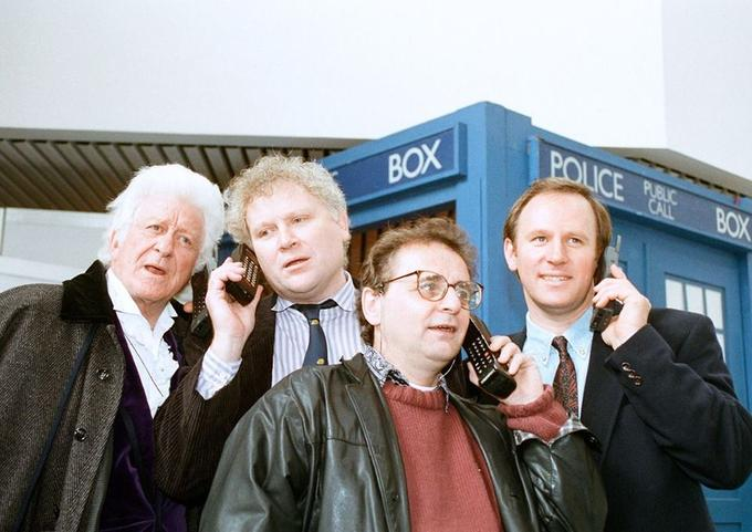 Theres a phonebox behind you y'know.