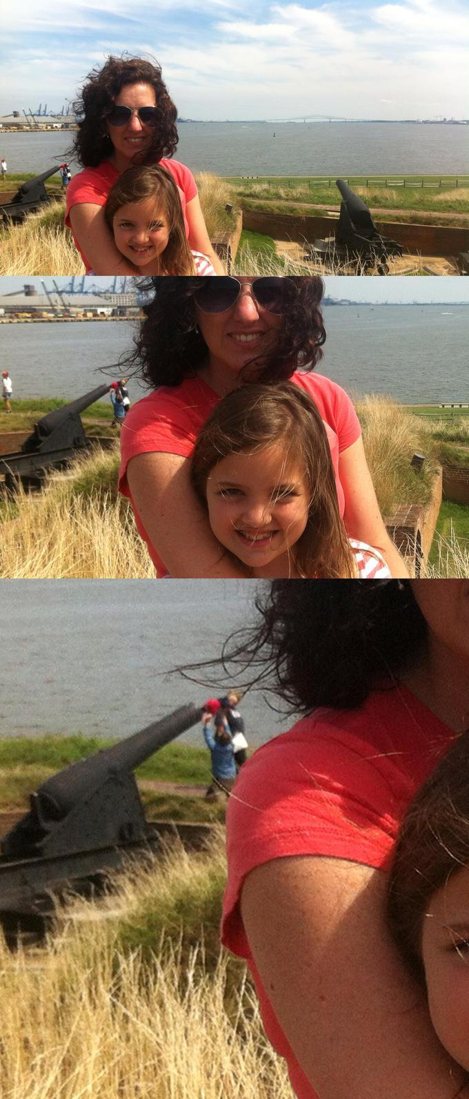 Some friends took a picture and later realized that the people in the background were stuffing a baby in a cannon.